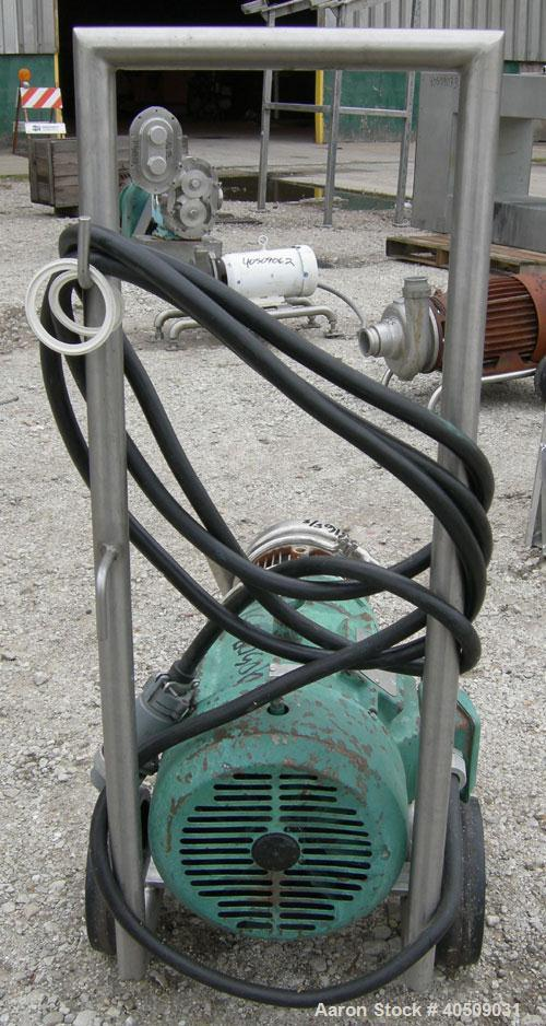 """Used- Tri-Clover Centrifugal Pump, model C216MD21T-S, 316 stainless steel. 2"""" tri-clamp inlet, 1 1/2"""" tri-clamp outlet. Appr..."""