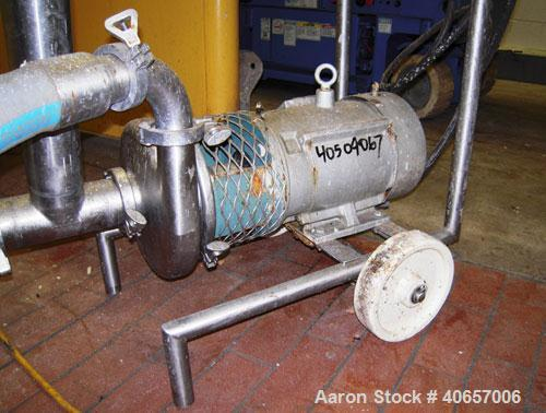 "Used- Tri-Clover Centrifugal Pump, Model C328MD18T-S, Stainless Steel. 3"" Tri-clamp inlet, 2"" tri-clamp outlet. Approximate ..."