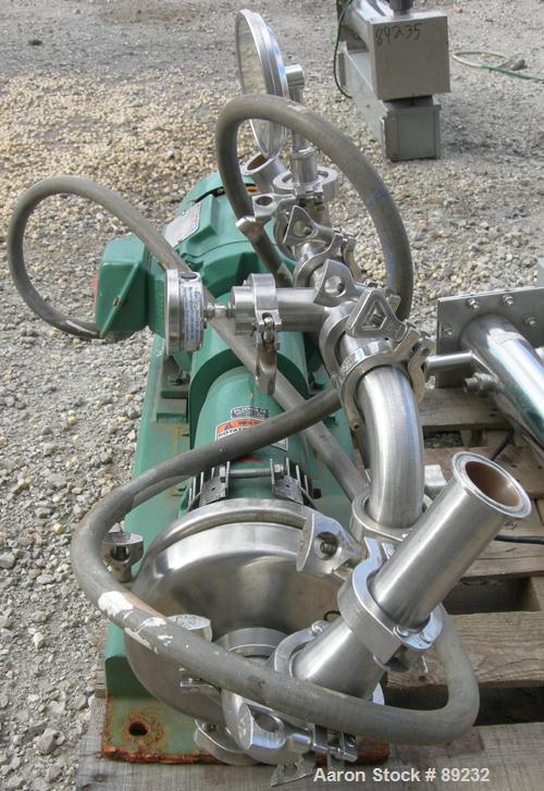 "USED: Tri Clover centrifugal pump, model SP216MY-S, 316 stainless steel. Approximate 6"" impeller, 2"" tri clamp inlet, 1-1/2""..."