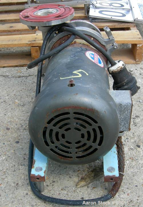 """USED: Waukesha centrifugal pump, model 2065, stainless steel. 2-1/2"""" tri clamp inlet, 2"""" tri clamp outlet. Approx 5-1/2"""" dia..."""