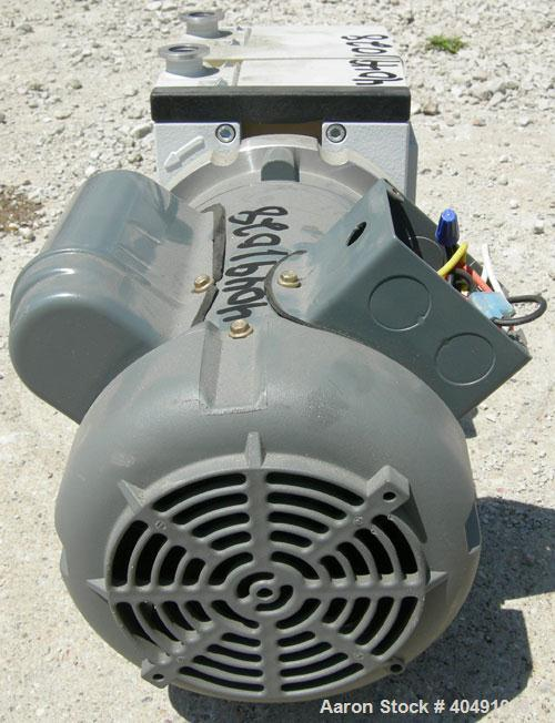 Used- Leybold Trivac oil sealed dual stage rotary vane vacuum pump, model D4B, carbon steel. Rated 3.4 cfm. 5/8'' inlet/outl...