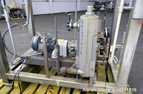 Used- Nash Two Stage Liquid Ring Vacuum Pump, Model XL35/5, Carbon Steel. Approximate 100 CFM. Driven by a 10hp, 3/60/460 vo...