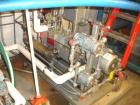 Used- Busch Single Stage Cobra Dry Screw Vacuum Pump, Model NC0070, Carbon Steel. Rated 50 cfm at .075 torr, jacketed chambe...