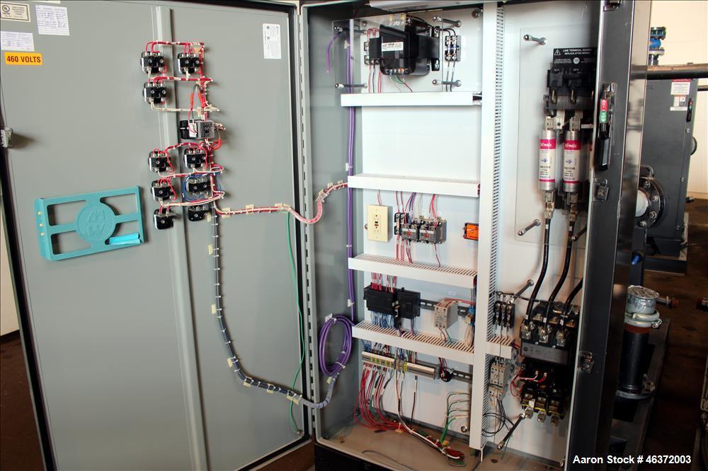 Used- Travaini Vacuum System, Model TRW1000H-FR, Carbon Steel. Consisting of Travaini vacuum pump, model TRHE100-1600/X-C/F,...