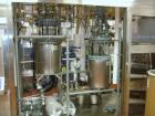 Used- Buchi Reactor Train consisting of: (1) Buchi 100 Liter Glass Reactor, (1) Buchi 100 Liter Glass Agitated Receiver, (2) Vertical Glass Coil Condensers, (1) Vertical Coil Vent Condenser.