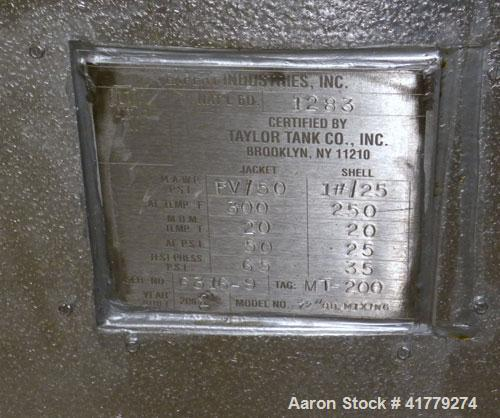 "Used- Taylor Tank Reactor, 1200 Gallon, 304 Stainless Steel, Vertical. 72"" x 60"" straight side, dished top and bottom. Inter..."