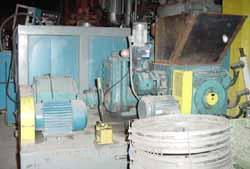 """Used- Ferro Tech Compactor/Briquetter, Model WP-30. 3"""" wide x 12"""" diameter 440 stainless steel rolls. Max roll size 6"""" x 12""""..."""