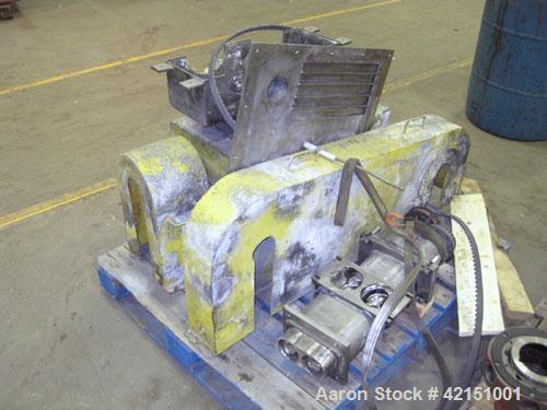 """Used- Fitzpatrick Stainless Steel Chilsonator, Model DM7LX10D. 10"""" diameter x 7"""" face  stainless steel rolls, approximate ca..."""