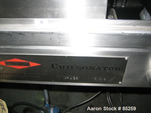 "USED: Fitzpatrick chilsonator, model IR520, stainless steel. Approx 2"" wide x 8"" diameter rolls, approx 6-24 rpm. Roll press..."