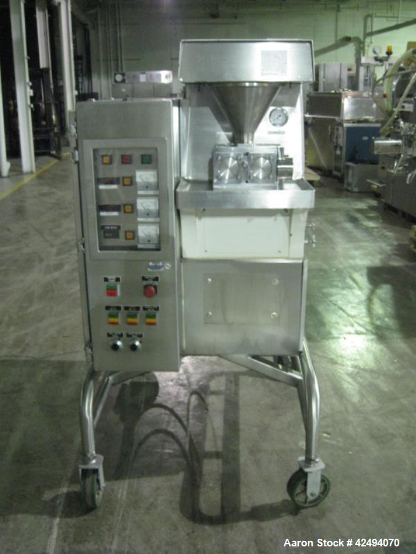 Used- Vector roller compactor, model TF-MINI, stainless steel product contact surfaces, 100 mm diameter x 35 mm faced rolls,...