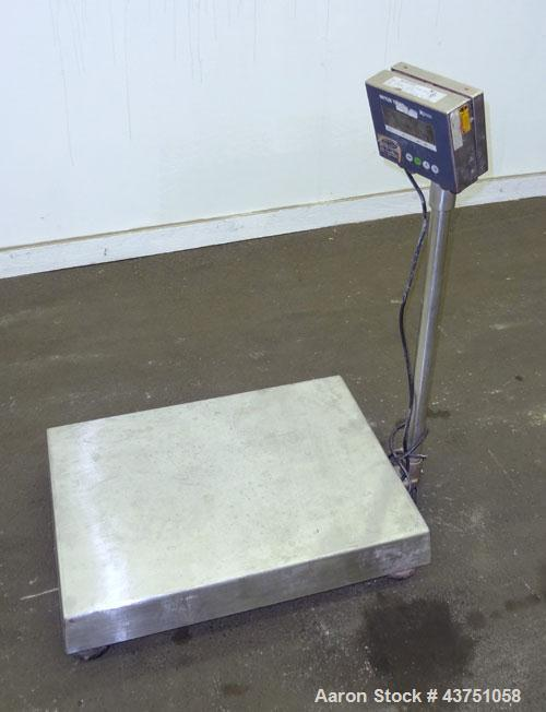 """Used- Mettler Toledo Xpress Floor Scale. 300 KG (661 Pound) capacity. 20"""" x 27"""" Stainless steel platform. Includes a XIF dis..."""