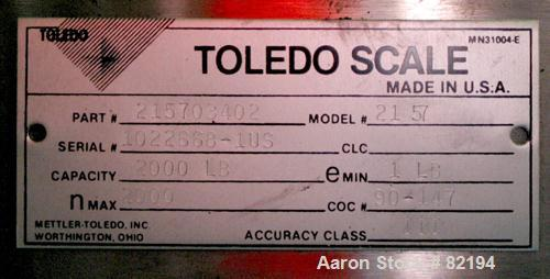 "USED: Toledo floor scale, model 2157. 2000 pound capacity, 48"" x 48"" diamond plate base. Includes a GSE model 350 readout."