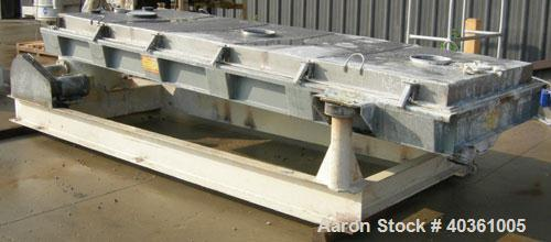 """Used- Rotex cooler, model 81C50. 304 stainless steel. Approximately 48"""" wide x 12' long carbon steel jacketed bed. Nominal 5..."""