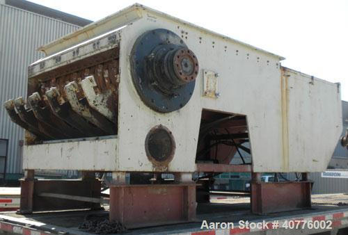 "Used-Holzmag Single Roll Shredder. Material of construction is carbon steel. 23.4"" (600 mm) diameter x 66"" (1690 mm) straigh..."