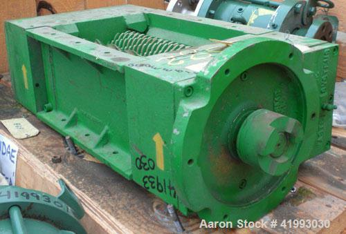 "Used- JWC Environmental Twin Shaft Open Channel Muffin Monster Shredder, Model 30001-12, Carbon Steel. (2) rows of  4-3/4"" d..."