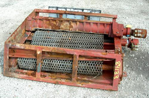 "USED: JWC Environmental twin shaft open Channel Muffin Monster shredder, model 30003-40. Carbon steel. (2) rows of 4"" diamet..."