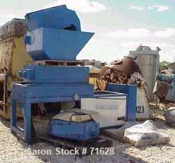 "USED: Lexxell 36 x 24 shredder, 36"" long x 24"" wide, (32) 1-1/8 thick 6 hook knives, feed hopper measures 28-1/2"" high x 54""..."