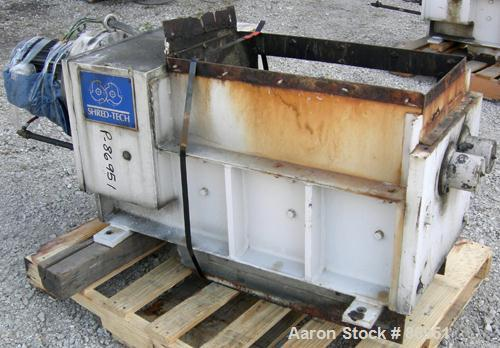 USED: Shred-Tech twin shaft shredder system consisting of (1) model ST-20E shredder, carbon steel. (2) Rows of 21 intermeshi...