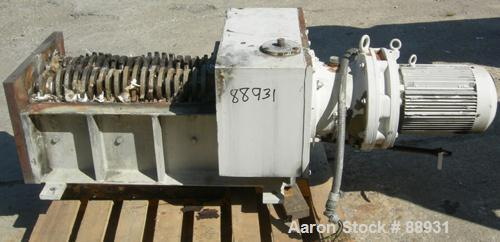 "USED: Shred-Tech twin shaft shredder, model ST-20E, carbon steel. (2) Rows of 21 intermeshing 6-7/8"" diameter x 5/8"" wide kn..."