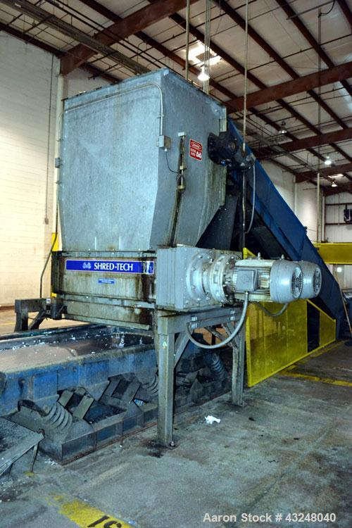 Used- Shred-Tech Dual Shaft Shredder, Model ST-75E, Carbon Steel. (2) Intermeshing shafts of hook blades, each driven by an ...