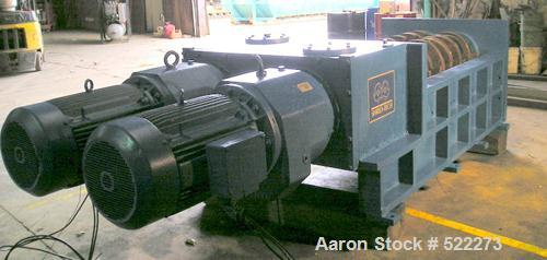 "USED: Shred Tech ST100 shredder. Cutting chamber is 62"" x 32"", dual shaft, slow speed shear type, two 50 hp drives."