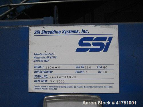 Used-SSI Shredder, Model 2400-4. Includes hopper, ram, control panel, stand, motor and conveyor. 4472 hours.