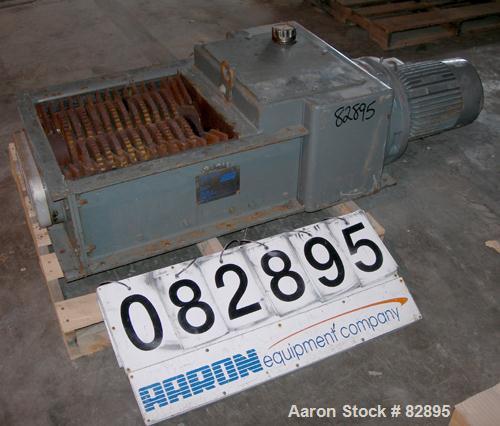 "Unused-UNUSED: SSI twin shaft rotary shear shredder, model 500E, carbon steel. (2) rows of 16 intermeshing cutters. 18"" x 19..."