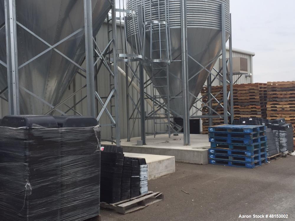 "Used- GSI Corrugated Silo, Model 12-4-60-16 . 1,706 cubic foot capacity. Galvanized steel. 12' diameter x 25' 10"" high. Cone..."