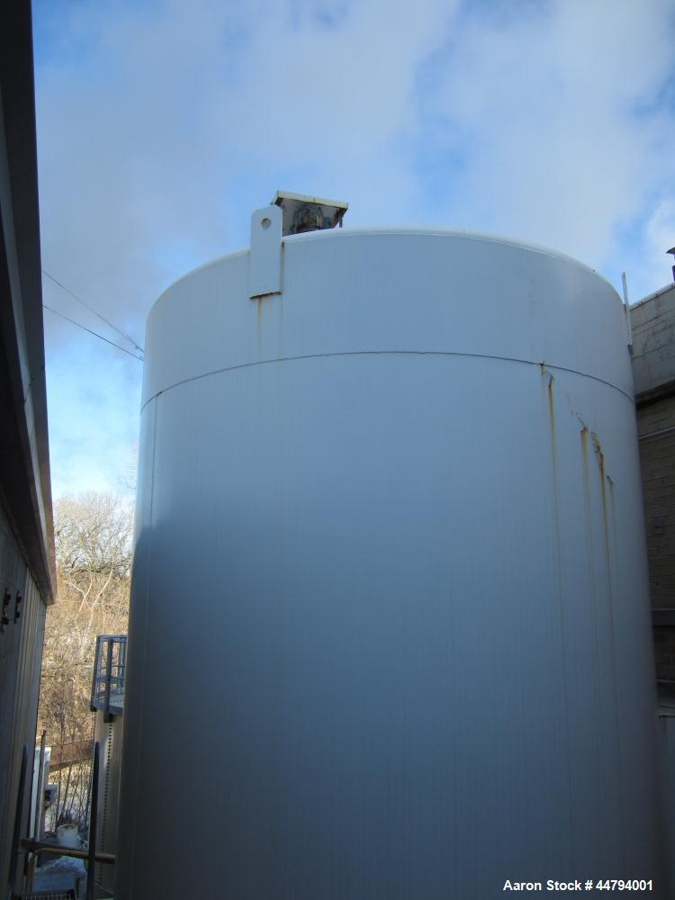 Used-APV Crepaco, 6000 gallon vertical silo, jacket rated 56 psi, dimple jacket, top driven agitator, 210 sq ft jacket surfa...