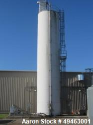 Used- Columbian TecTank / Silo, 3,940. 12 diameter x 55 high. Carbon Steel. Skirt mounted. Available at extra cost: Pneumati...