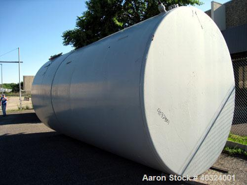 """Used- Tank, 12,300 gallon, carbon steel, horizontal. Approximately 10'6"""" diameter x 19' straight side, flat ends. Side manwa..."""