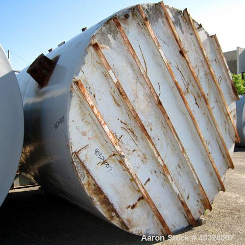 Used- Tank, 8500 gallon, carbon steel,  vertical. Approximately 11' diameter x 12' straight side, dished top, flat bottom. T...