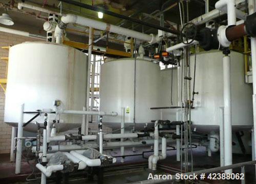"Used-  Liquid Storage System With (4) Mild Steel Tanks 90""H X 90"" Dia. With Lightnin Agitators & Pneumatic Valves"