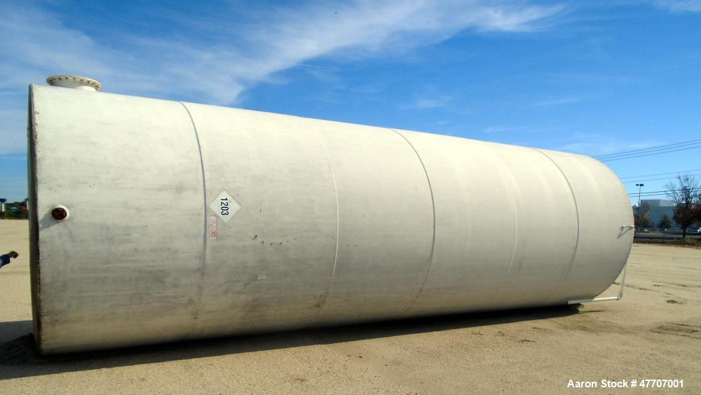 "Used- 20,000 Gallon Upright Surface Tank. Carbon steel, 32' high x 10'-5"" diameter. 9"" access port, 4.5"" drain/inspection fi..."