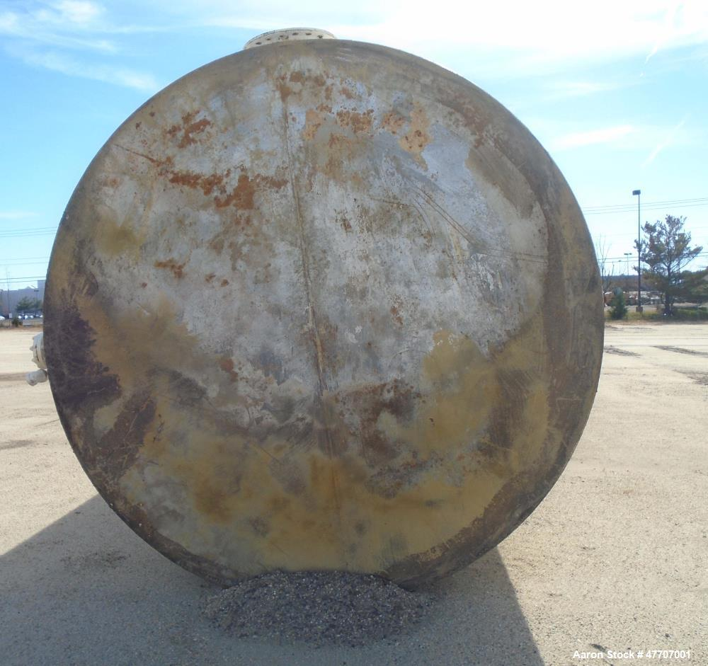"""Used- 20,000 Gallon Upright Surface Tank. Carbon steel, 32' high x 10'-5"""" diameter. 9"""" access port, 4.5"""" drain/inspection fi..."""