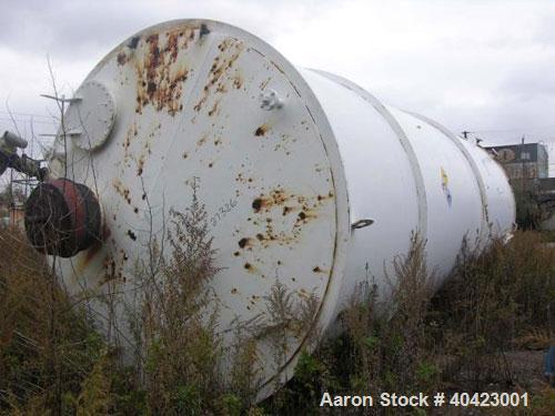 """Used-Clawson Tank, 18,000 gallon, carbon steel. Approximately 10' diameter x 30' straight side. Flat top and bottom. 24"""" sid..."""