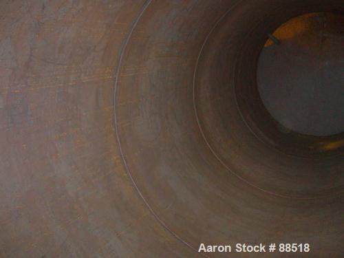USED: Clawson tank, 9,000 gallon, carbon steel. Approximately 8' diameter x 24' straight side. Slight coned top, flat bottom...