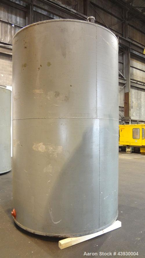 "Used- Tank, Approximately 3100 Gallon, Carbon Steel, Vertical. 84"" Diameter x 130"" straight side, flat top and bottom. Openi..."