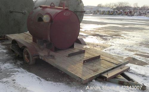 "Used- Tank, Carbon Steel, 450 Gallon, Horizontal. Approximately 48"" diameter x 60"" straight side. Flat ends. Openings top (2..."