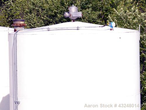 """Used- Silo, 4009 Cubic Feet (30,000 Gallon), Carbon Steel. Approximate 144"""" Diameter x 36' tall. Dished top, flat bottom. 18..."""