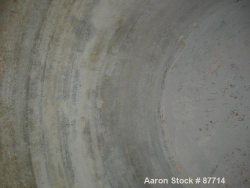 "Used- Tank, 6200 Gallon, Fiberglass, Vertical. Approximately 116"" diameter X 136"" straight side. Slight cone top, flat botto..."