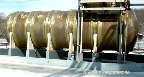 "USED: Wallace Murray tank, 34,000 gallon, fiberglass, horizontal. Approx 144"" diameter x 40' long. Dished ends. End bottom o..."