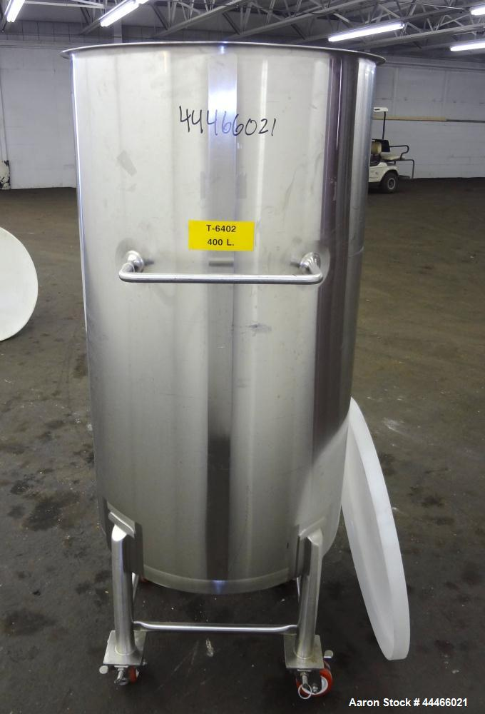 "Used- Tank, 106 Gallon (400 Liter), 316 Stainless Steel, Vertical. Approximate 27-1/2"" diameter x 47-1/2"" straight side, ope..."