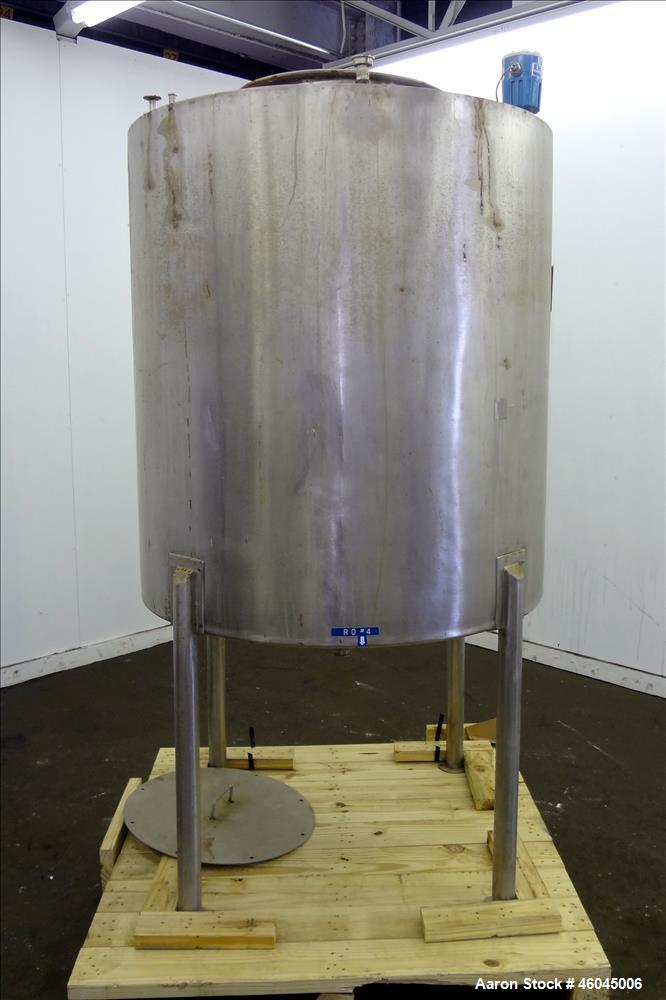 """Used- Tank, Approximate 330 Gallons, 304 Stainless Steel, Vertical. 45"""" diameter x 48"""" straight side, slight cone top, cone ..."""