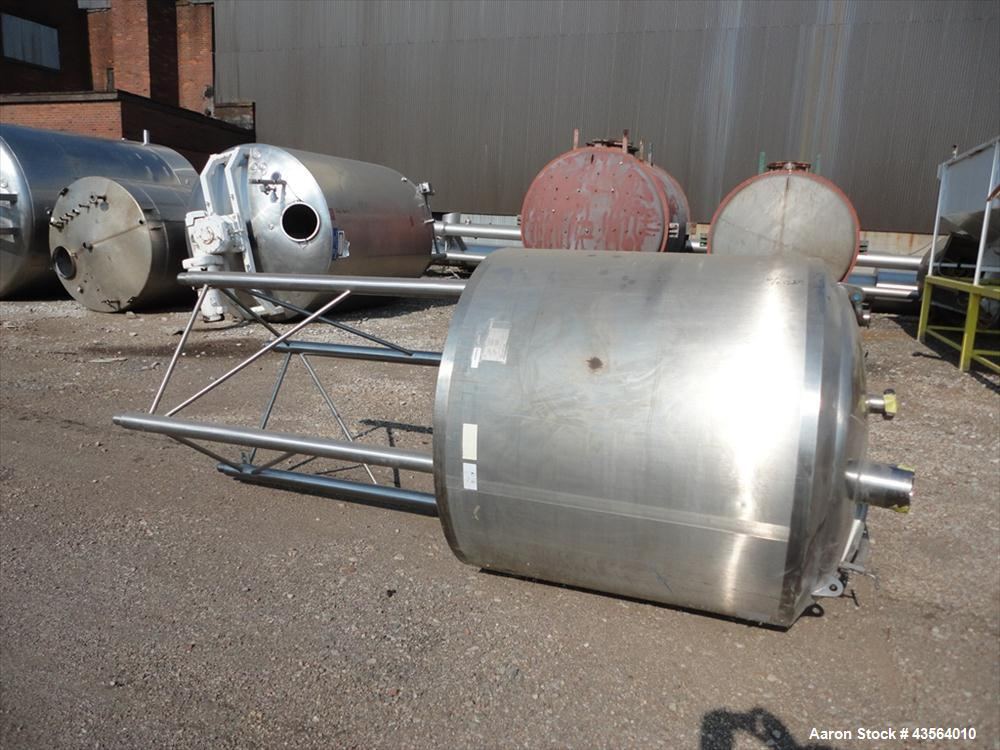 """Used- APV Crepaco Tank, 330 Gallon, Stainless Steel. Approximately 48"""" diameter x 42"""" straight side, dish top, flat bottom, ..."""