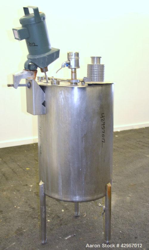 Used- Cherry-Burrell Tank, 65 Gallon, 304 Stainless Steel, Vertical. 24'' Diameter x 34'' straight side. Open top with a 2 p...