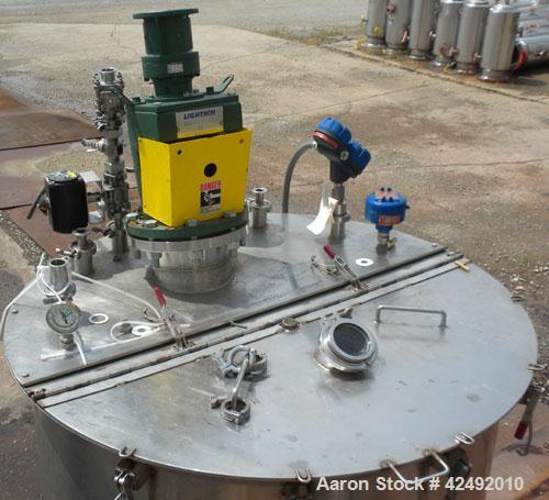 """Used- Tank, 440 Gallon, 304 Stainless Steel, Vertical. 48"""" Diameter x 52"""" straight side. Open top with a 2 piece cover, 1/2 ..."""