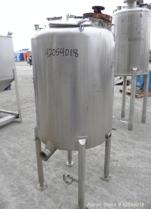 """Used- Tank, 100Gallon, 316 Stainless Steel, Vertical. 30"""" diameter x 36"""" straight side, dish top, sloped bottom. 1-1/4"""" dia..."""