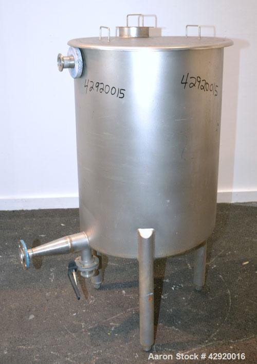 Used- Tank, 65 Gallon, 304 Stainless Steel, Vertical. 24-1/2'' Diameter x 33'' straight side. Flat open top with a 1 piece c...
