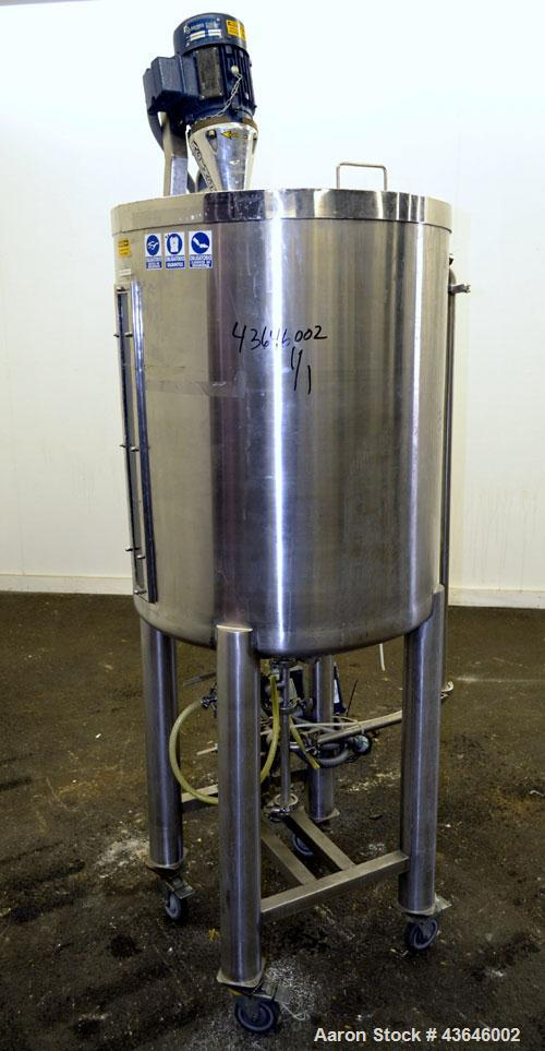 "Used- Tank, 90 Gallon, 304 Stainless Steel, Vertical. Approximate 28"" diameter x 32"" straight side. Flat top with a 1/2 hing..."